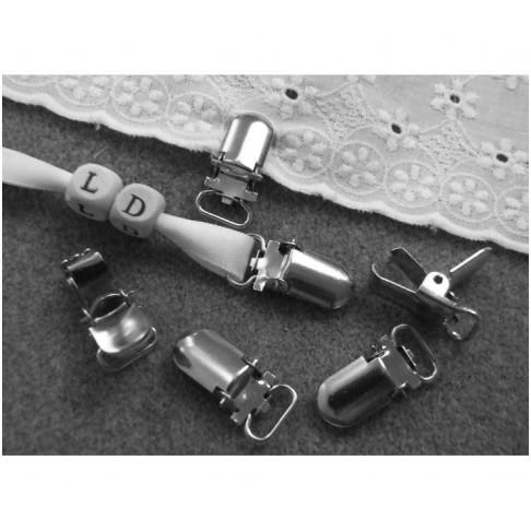 7-81122 Laikiklis-spaustukas, 27x12mm., platinos sp.